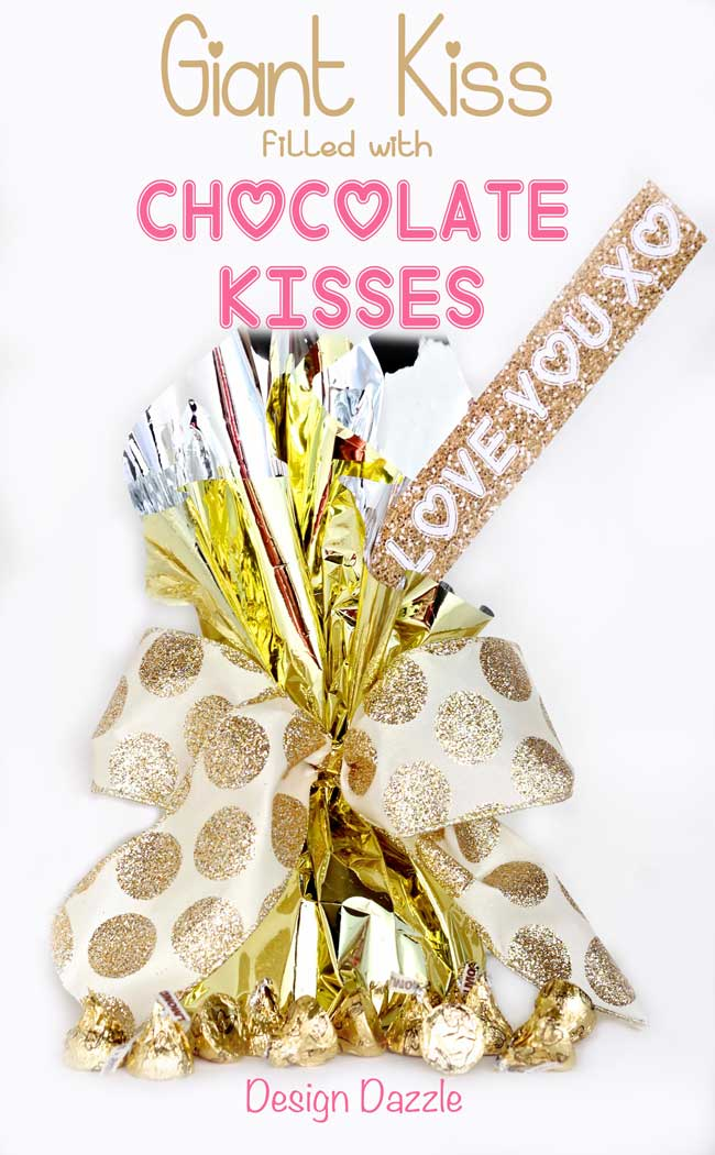 Instructions to make your own Giant Valentine Kiss filled with chocolate kisses! Free printables for Valentine kiss slip! Design Dazzle