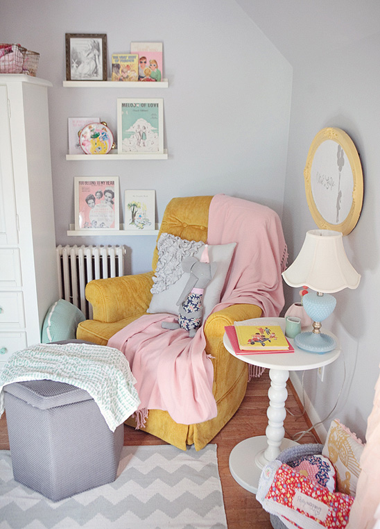That mustard chair? Dying. This vintage nursery is absolute perfection!
