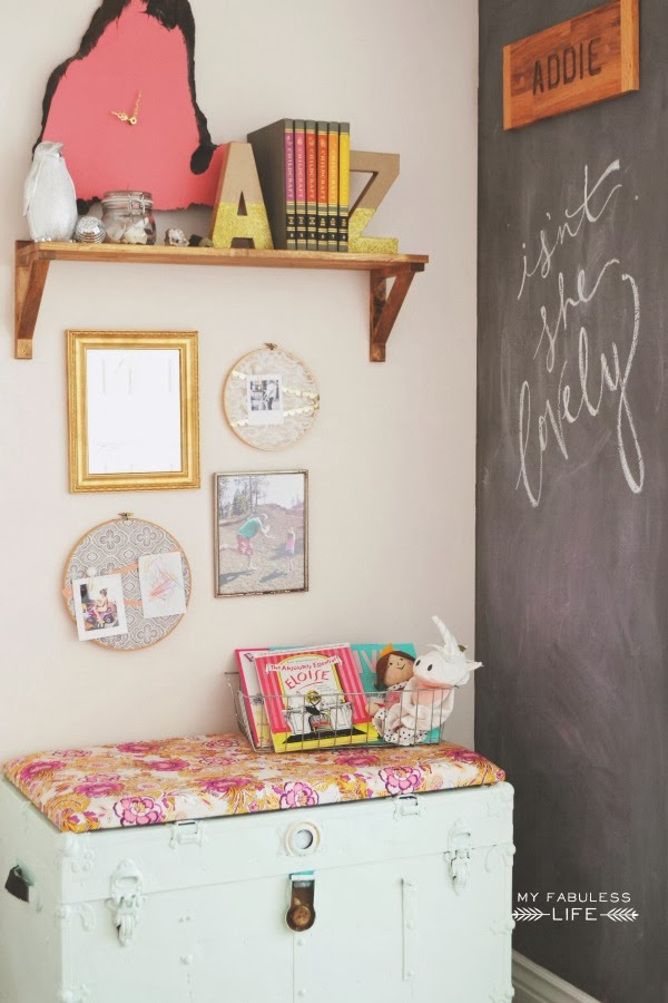 I adore this chalkboard wall. This is a BEAUTIFUL eclectic kids room!