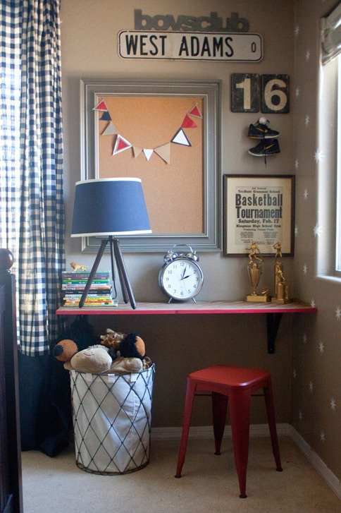 An old pinball machine and some antique wooden legs have come back to life as a sewing table. The red ladder-back chair and graphic-patterned rug give the space a modern twist on an old-fashioned style.