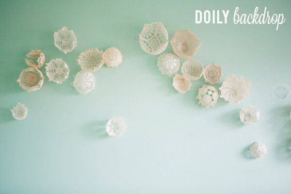 This is a gorgeous DIY photo backdrop! Doilies are beautiful!