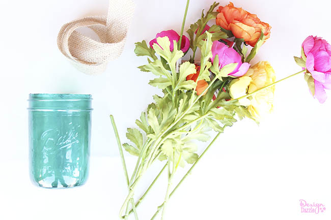 Create a beautiful tinted mason jar centerpiece for your farm chic bash! See how on Design Dazzle.
