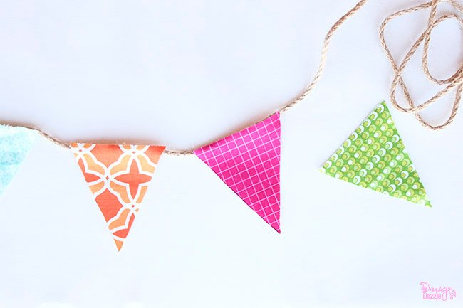 Making a mini fabric banner is simple! Check it out on Design Dazzle.