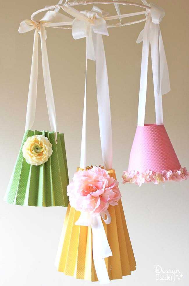 Make paper lampshades to hang on a sweet mobile! Tutorial on Design Dazzle.