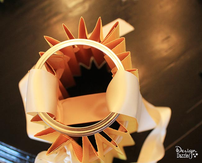 Paper lampshades are the perfect addition to your kids room! Learn how to make it on Design Dazzle.
