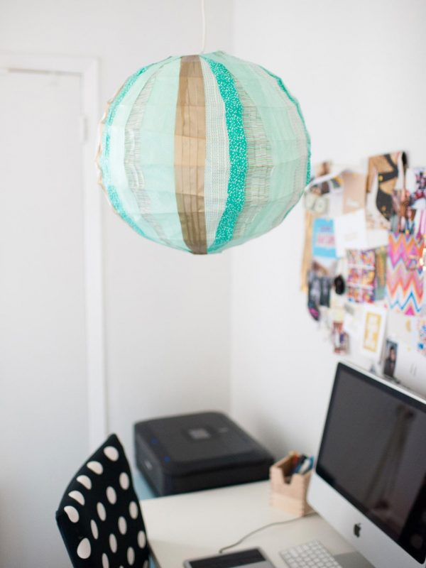 Use washi tape to create a unique paper lantern light for your dorm
