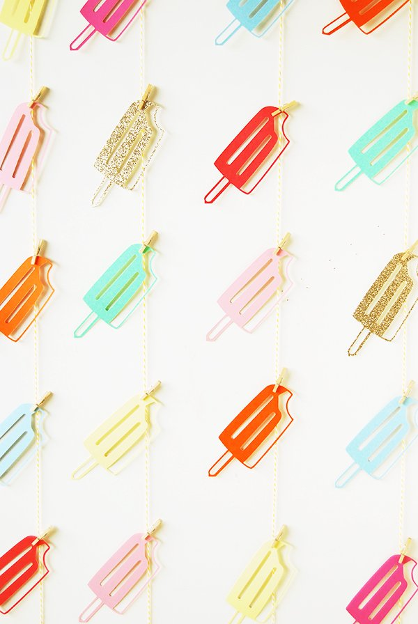 Create your own colorful popsicle backdrop for your end of summer party