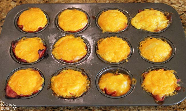 Looking for easy breakfast ideas? You'll love these ham, egg, and cheese muffin cups! Recipe on Design Dazzle.