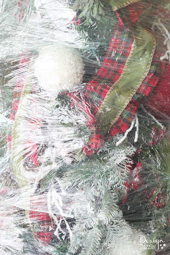 This year, wrap up your Christmas tree for easy storage! The BEST Christmas decorating and time-saving tip ever!! Wrap up your artificial DECORATED Christmas tree and store for next year. No putting away your ornaments and taking down the tree. LOVE this idea! Design Dazzle