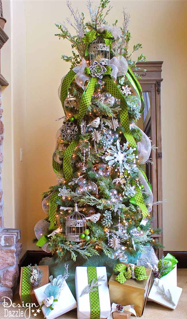Jeweled Forest Christmas Tree designed by Toni Roberts of Design Dazzle. Moss, succulents, birds and bircages with touches of sparkle make this a jeweled forest tree.