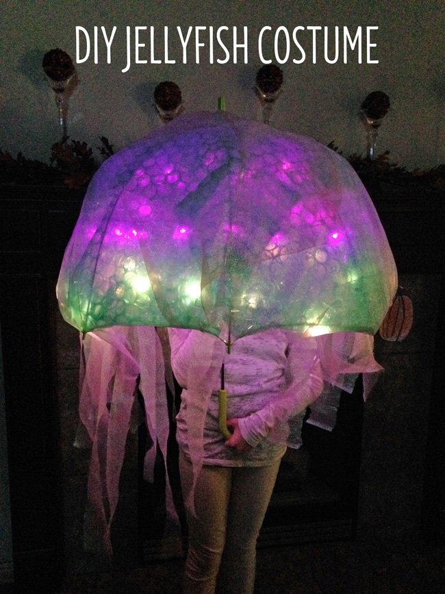 DIY Jellyfish Halloween Costume that lights up. Easy no-sew tutorial to create a darling and super fun halloween costume. Shared on Design Dazzle