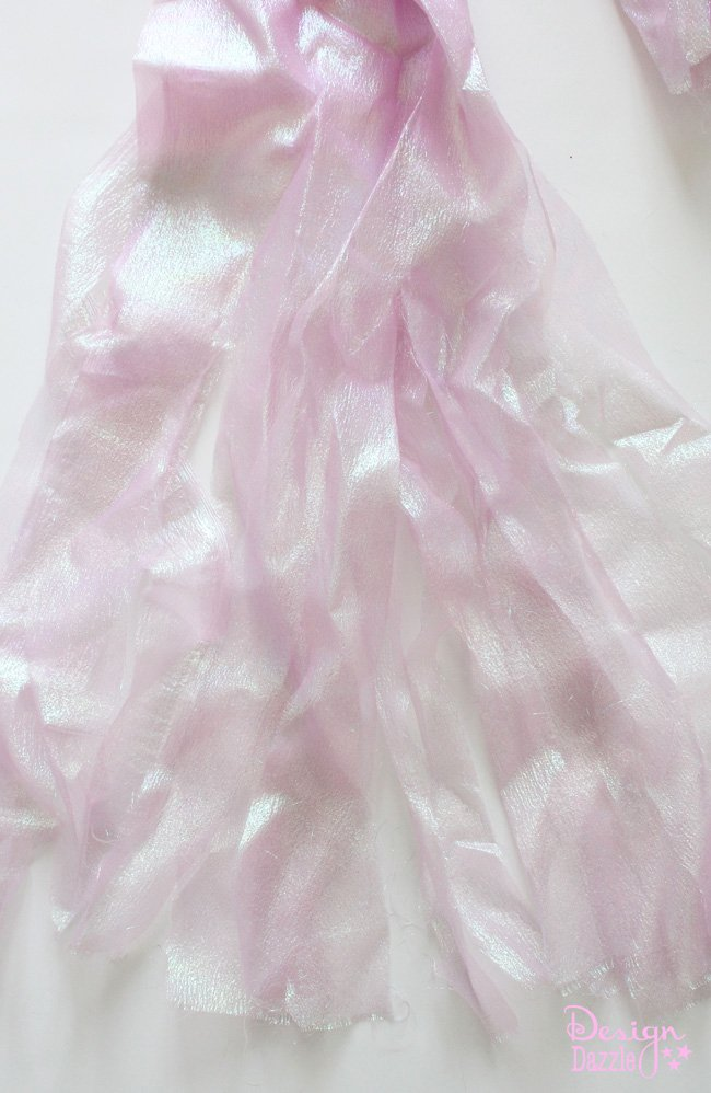 Iridescent fabric for DIY jellyfish costume. DIY Jellyfish Halloween Costume that lights up. Easy no-sew tutorial to create a darling and super fun halloween costume. Shared on Design Dazzle