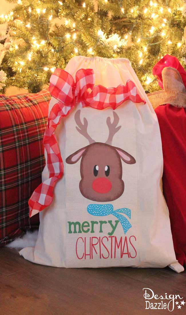 Simple And Easy To Make Santa Sacks! Use a laundry bag or pillowcase and our Deer Merry Christmas printable. Super cute and such an awesome family tradition! Design Dazzle