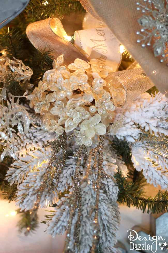 Winter Wonderland Glam Christmas Tree designed by Toni Roberts of Design Dazzle. Snow tipped branches, gold hydrangeas, white roses, lots of bling and touches of galvanized metal create this Winter Wonderland Glam Tree.