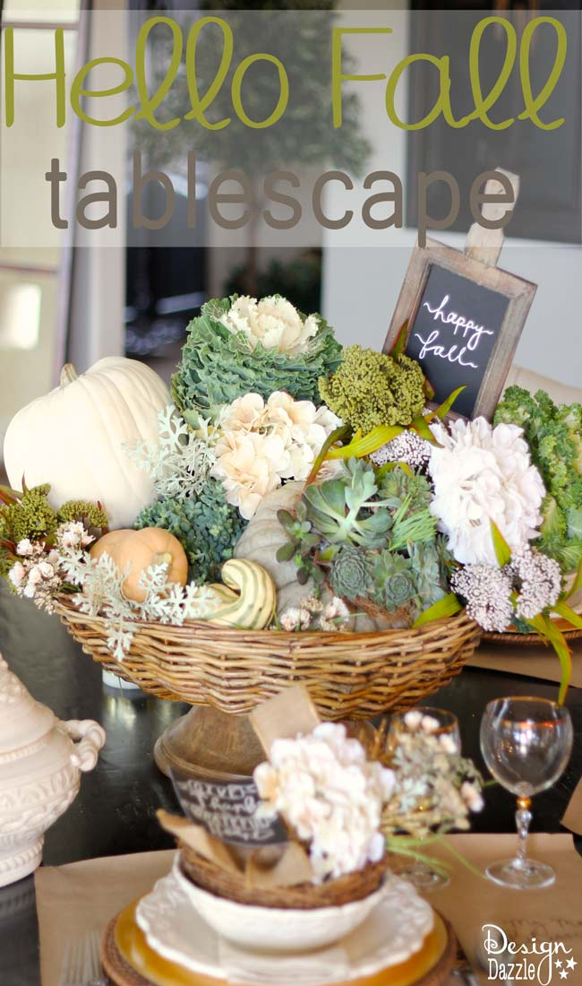 Succulents, ornamental cabbages, winter squash used with neutrals and a touch of glitz to create a stunning Thanksgiving tablescape. || thanksgiving decor | tablescape ideas for thanksgiving | decorating for fall | fall table decor | thanksgiving table decor || Design Dazzle #thanksgivingdecor #falltablescape #falltabledecor
