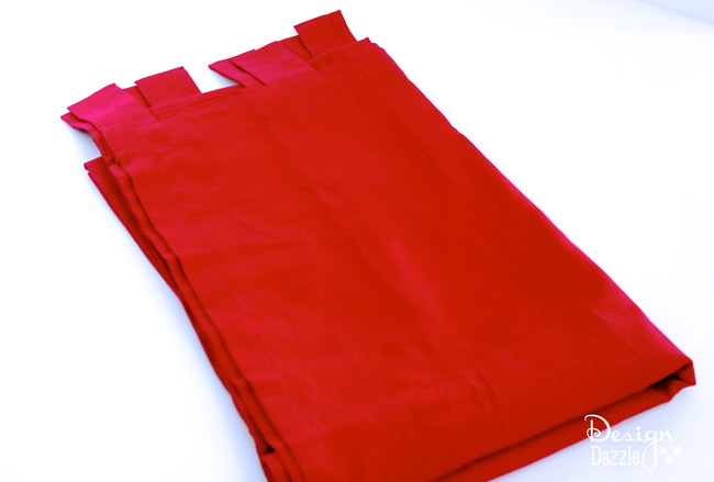 Red tab top curtains made into Santa Sacks (gift bags). Design Dazzle