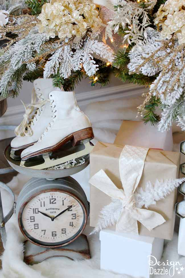 Ice skates under the tree. Winter Wonderland Glam Christmas Tree designed by Toni Roberts of Design Dazzle. Snow tipped branches, gold hydrangeas, white roses, lots of bling and touches of galvanized metal create this Winter Wonderland Glam Tree.