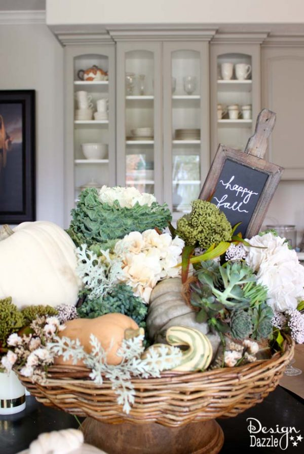 Happy Fall! Succulents, ornamental cabbages, winter squash used with neutrals and a touch of glitz to create a stunning Thanksgiving tablescape. Design Dazzle