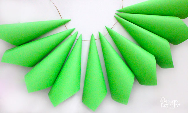 Create a whimsical Grinch paper cone Christmas tree! Design Dazzle shows you how.