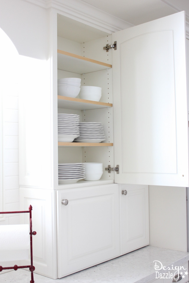 The INSIDE of the cabinets are pretty plain and quite dull. Here is an unexpected detail and fun surprise when you open the kitchen cabinet doors! It went from boring and plain - to a party on the inside! I smile every time I open the door! See the details on how to create this for more than a kitchen a craft room, bathroom, bedroom, etc. Design Dazzle