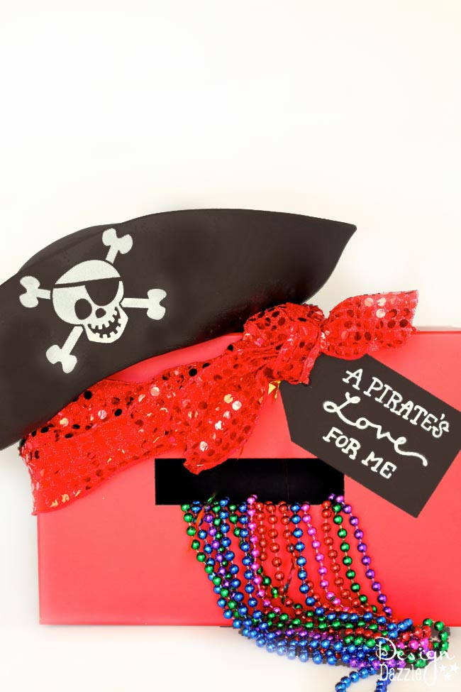 "Craft with your kids this easy and cute Pirate Valentine Card Holder complete with FREE printable tag "" A Pirate's Love For Me!"" Design Dazzle"