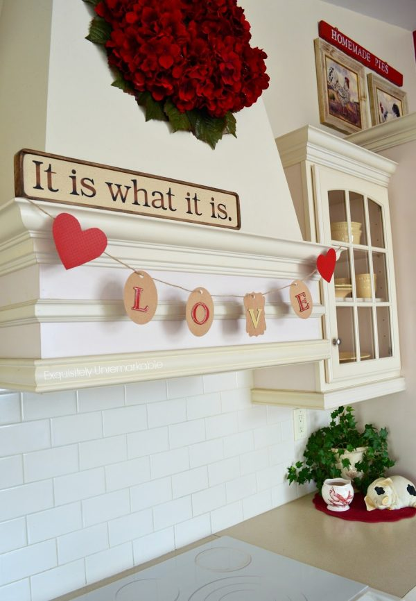 DIY Valentine LOVE Banner that is so cute hanging in this kitchen!