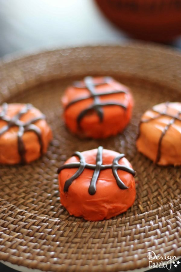 Easy Basketball Snack Cakes Made With Ding Dongs. Cute party idea for a absketball party or March Madness theme. Enjoy making with your family! Design Dazzle
