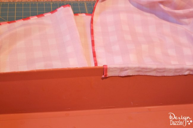 The no-sew diy valance made from a plastic window box. Use a glue gun and a table cloth to create a darling valance. Design Dazzle
