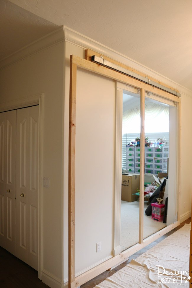 How to build a sliding wall to create a secret room. Yes, the wall slides open. Details on Design Dazzle
