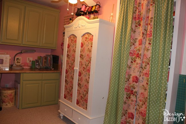 Craft room created using old kitchen cabinets. The tree with the blossom added just the right touch to my craft room. I loved turning on the fairy lights and crafting in there! Design Dazzle