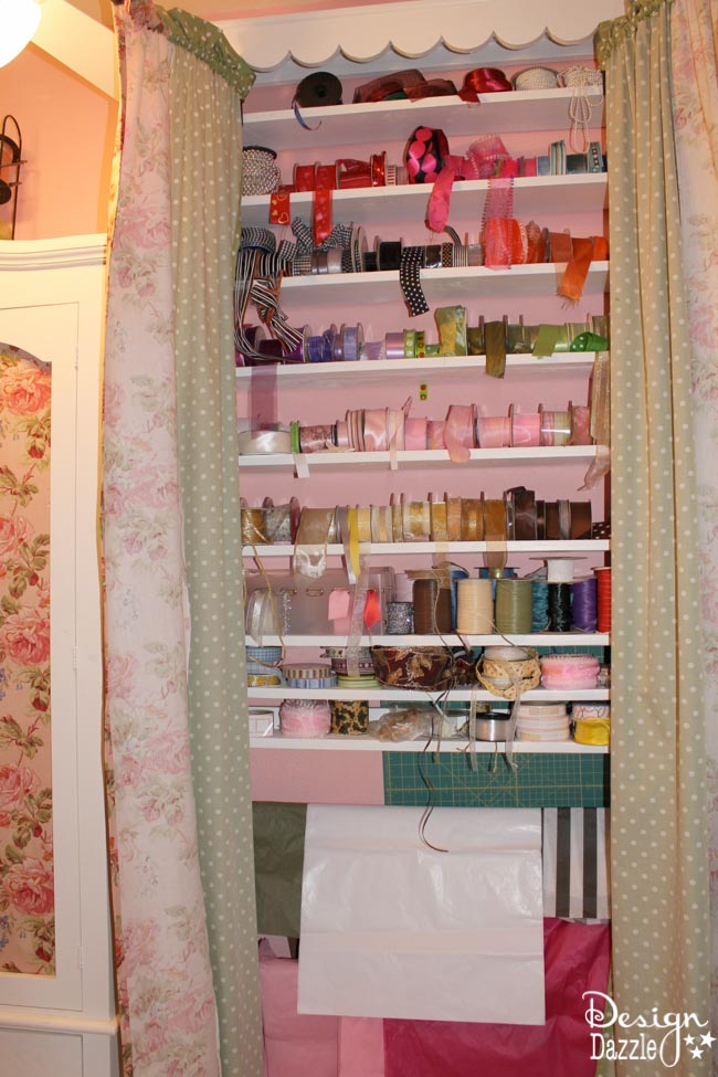 """Craft room created using old kitchen cabinets. Love my """"ribbon case"""". I enjoyed turning on the fairy lights and crafting in there! Design Dazzle"""