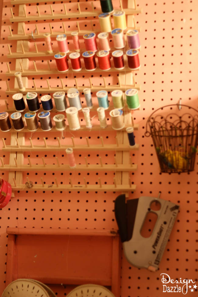 Craft room created using old kitchen cabinets. The tree with the blossom added just the right touch to my craft room. I loved turning on the fairy lights and crafting in there! Pegboards really help organize lots of craft products. Design Dazzle