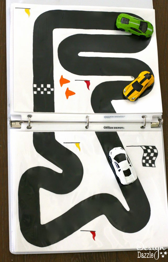 Racetrack Binder Free Printables! Summer is the perfect time to start a 3 ring binder for kids games/activities and start getting organized for play and travel. Print the racetrack on cardstock, place in a page protector and put in the binder! Design Dazzle