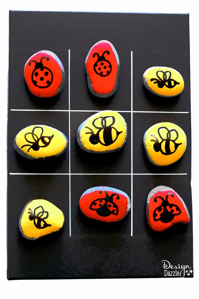 Tic Tac Toe Stones Game Box will keep the kids entertained! Paint your own stones and create your very own Tic Tac Toe game.   Design Dazzle