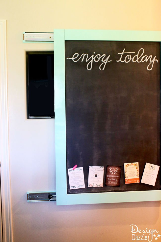 This magnetic chalkboard slides to reveal the hidden kitchen TV. | Design Dazzle