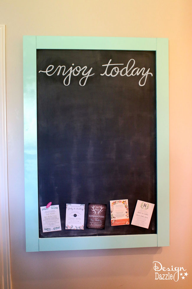 This magnetic chalkboard slides to reveal the hidden kitchen TV.   Design Dazzle