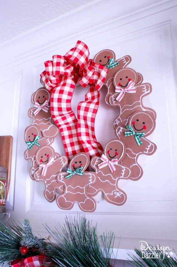 Hanging a Christmas wreath in the kitchen