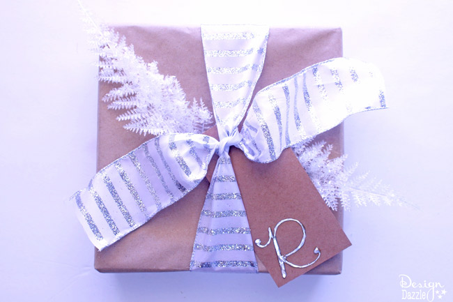 gold-presentsAn easy way to dress up simple, basic packaging can be done with colorful, bright, glittery, simple or festive ribbon and beautiful bows!  | Design Dazzle