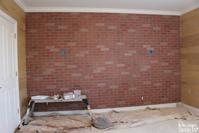 Do you want to have a brick accent wall in your bedroom but think it's too expensive? This post shows how to make faux brick paneling look real. | Design Dazzle