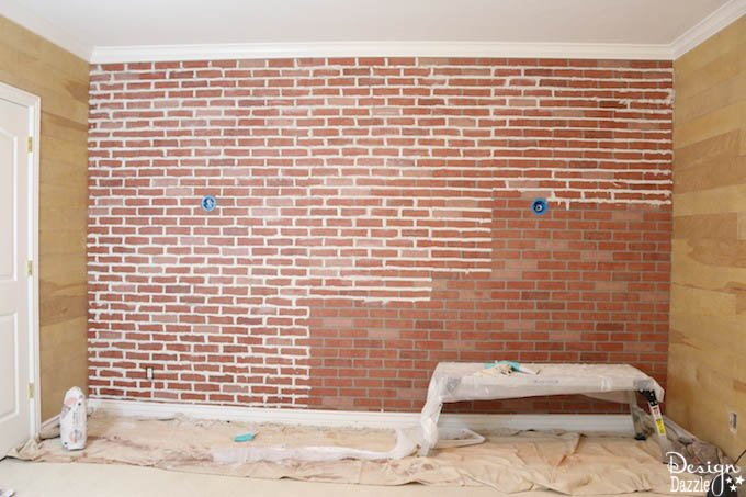 Would you like e a brick accent wall in your bedroom but think it's too expensive? This post shows how to make faux brick paneling look real. | Design Dazzle