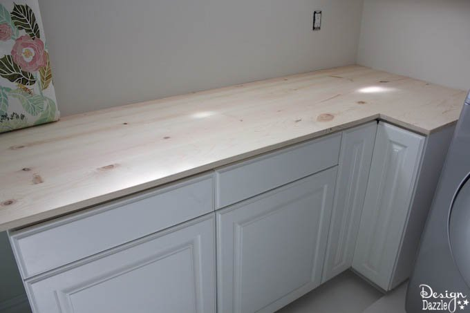 This post shows how to create gorgeous wood countertops and durable, trendy white flooring in my Laundry Pantry Room combo!   Design Dazzle