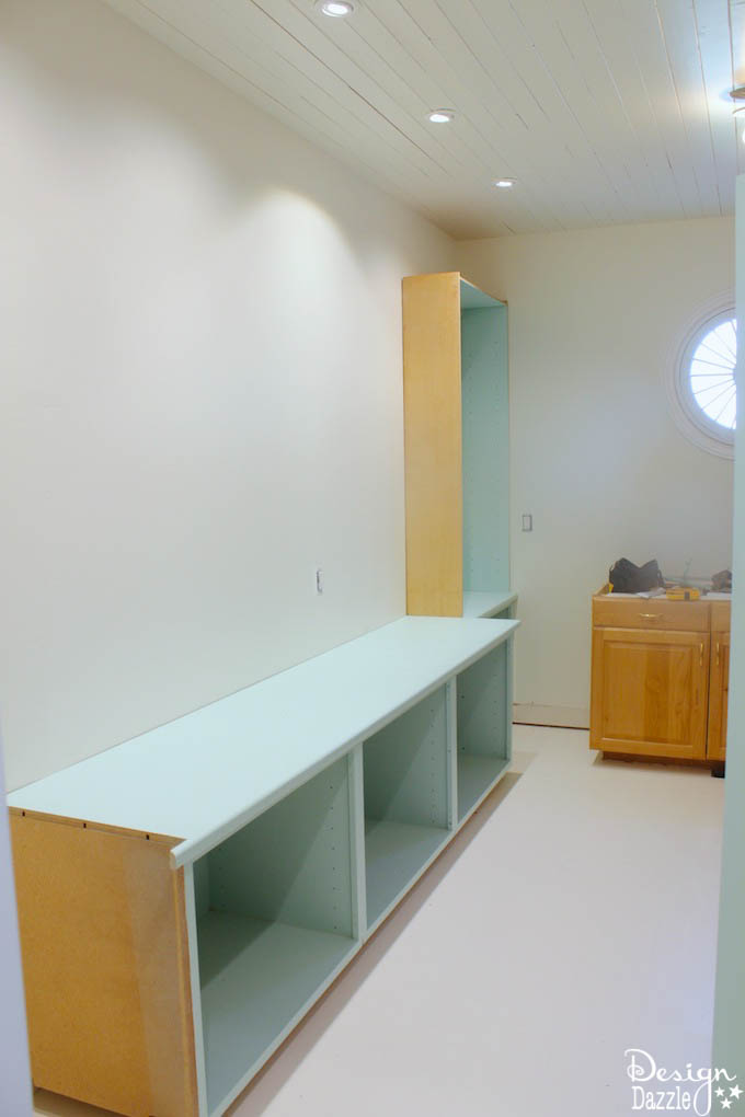 This post shows how to create gorgeous faux custom built in cabinets on a budget that fit perfectly in my Laundry Pantry Room combo! | Design Dazzle