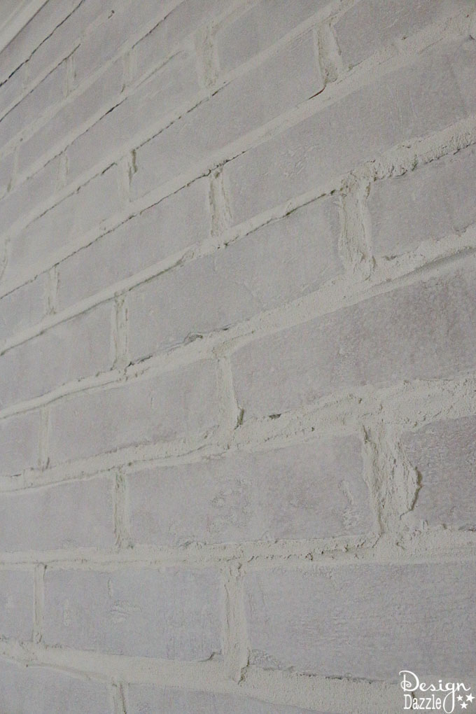 This post shows how to take fake brick wall paneling and turn it into a real looking, white washed brick wall! The perfect solution if you're on a budget. | Design Dazzle