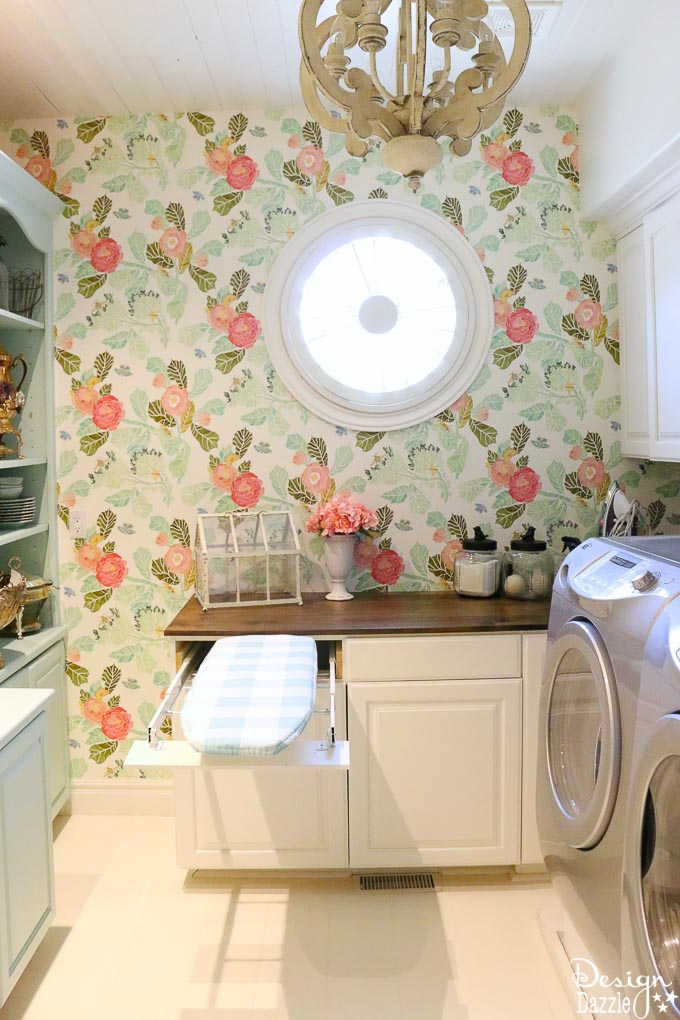 This post shows how to create a swing door out of a regular door and a convenient pull out ironing board in my Laundry Pantry Room combo! | Design Dazzle