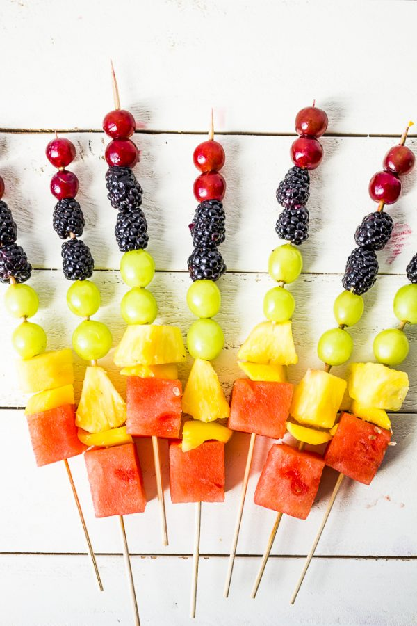 Scrap the sugar-filled popsicles and cool off with these DIY fruit kabobs!