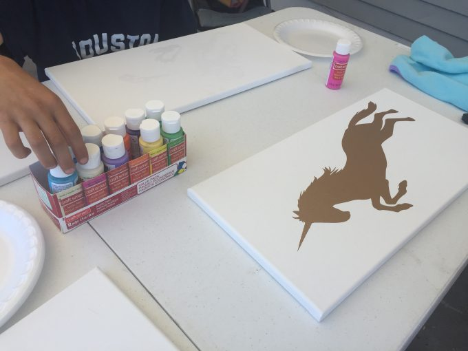On a budget? You can still have a blast this summer! Learn how to make cute canvas art with the kiddos this summer while still sticking to a budget!