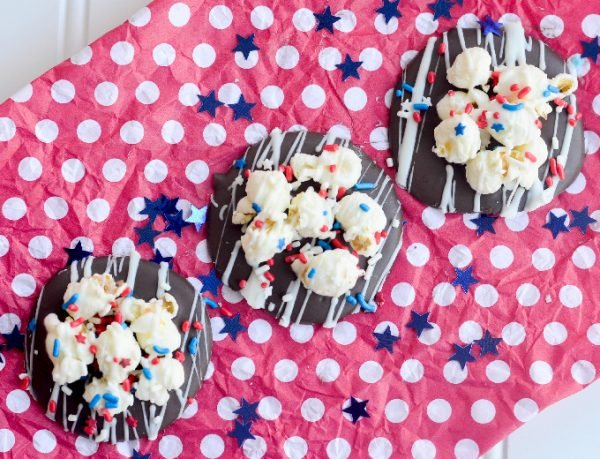 The hardest part of these Patriotic Chocolate Popcorn Puddles is waiting for the chocolate to set! These are a super delicious and simple treat to make!