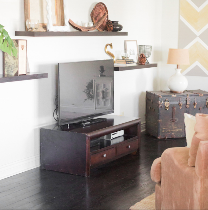 This post will give you some of my favorite tips and tricks on how to decorate around your TV and still make your room look gorgeous! | Design Dazzle