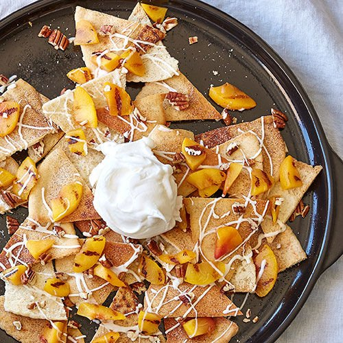 If you're looking for a great way to follow up your hearty plate of nachos, then these delicious dessert nacho recipes might be just what you're looking for! Design Dazzle