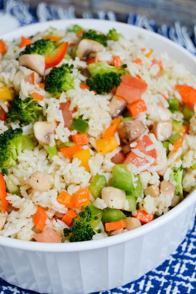 This Garden Veggie Rice Salad is not only healthy and delicious but also leaves you feeling full and satisfied afterwards. It's so quick to put together!   healthy rice recipes   healthy vegetable recipes   simple dinner recipes   quick dinner recipes   healthy dinner recipes   how to use garden vegetables   garden vegetable recipes    Design Dazzle #healthyrecipes